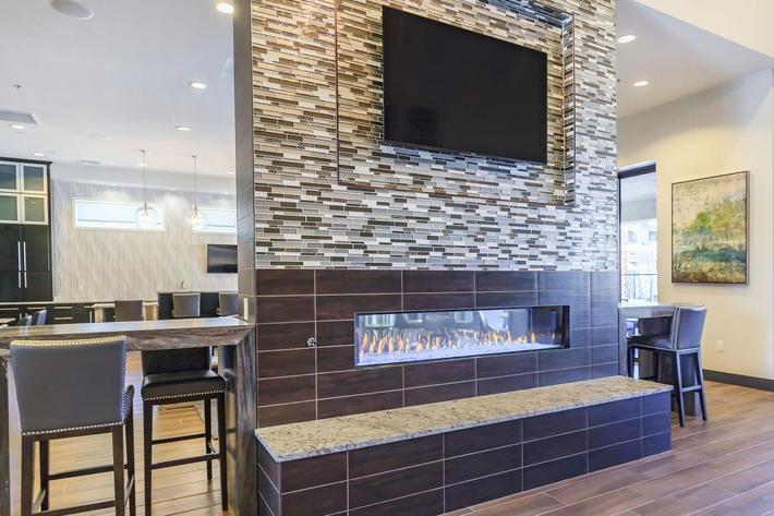 Dual Sided Fireplace with Flat Screen TV at Level 25 at Durango