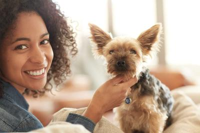 Woman & Small Dog - iStock-494342984.jpg
