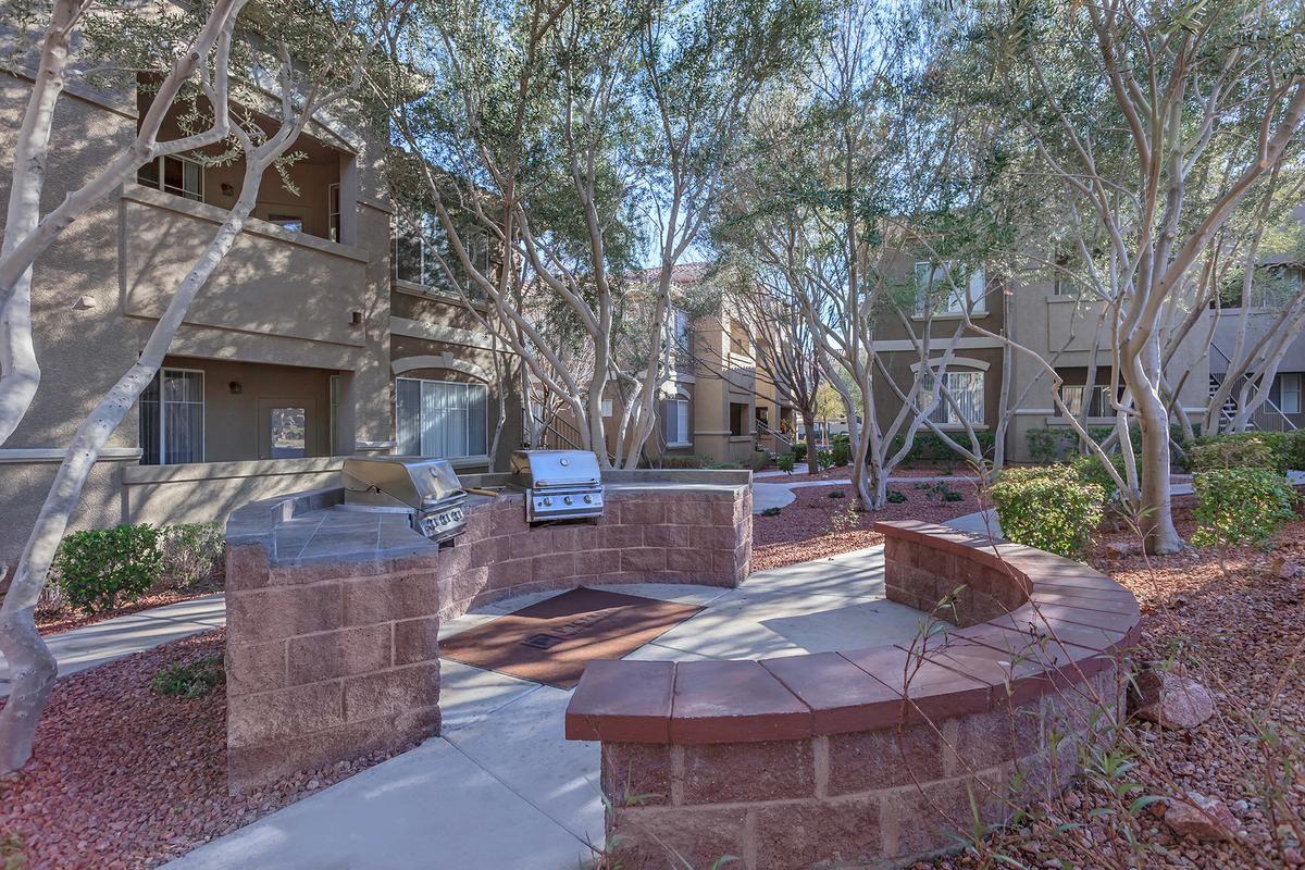 Modern Picnic Area with Barbecue at The Covington at Coronado Ranch Apartments