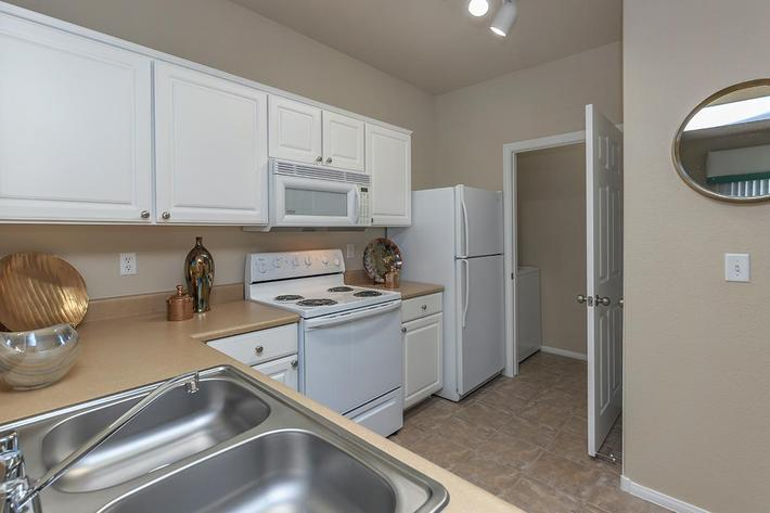 All-electric Kitchens in Homes at The Covington at Coronado Ranch Apartments