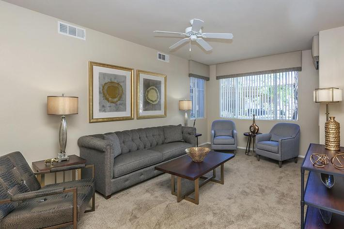 Ceiling Fans, Vertical Blinds, and Carpeted Floors in Homes at The Covington at Coronado Ranch Apartments