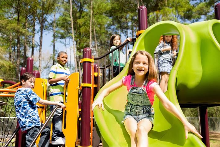 Elementary children play at school recess or park on playground iStock-480629461.jpg