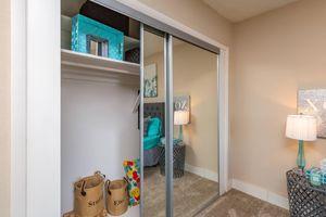 a bedroom with a green door