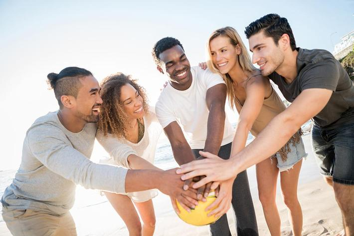 People playing volleyball at the beach iStock-505693486.jpg