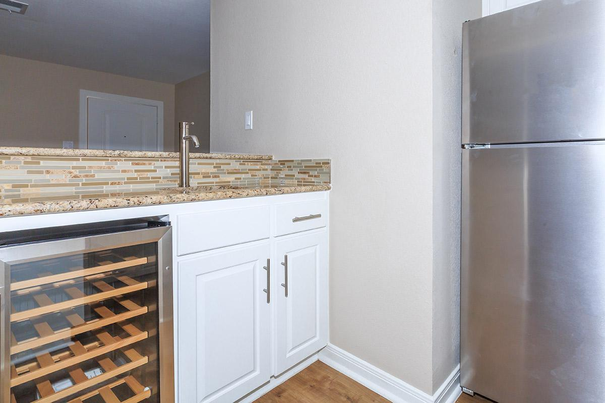 BUILT-IN WINE FRIDGE AT DOMINION AT OAK FOREST APARTMENTS