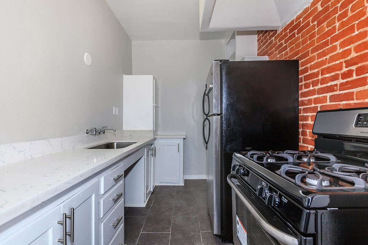 Kitchen equipped with stainless steel appliances at Ancelle
