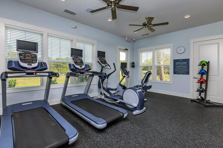 24-hour fitness center at The Townhomes at Beau Rivage in Wilmington, North Carolina.