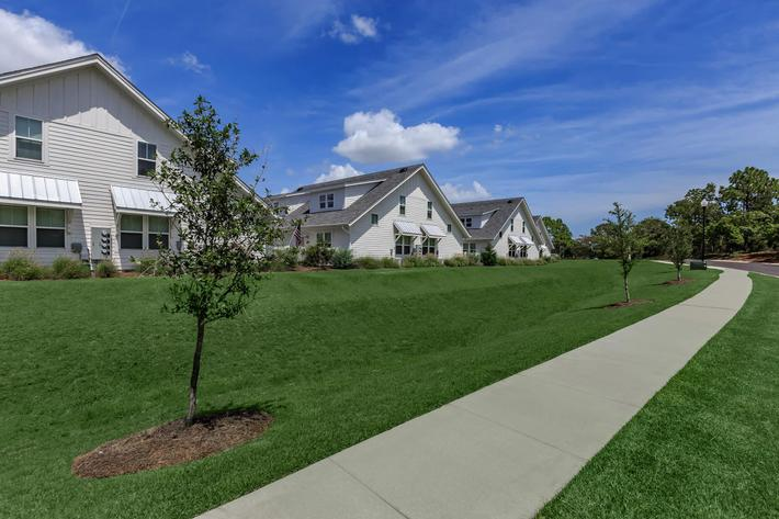 Beautiful landscaping at The Townhomes at Beau Rivage in Wilmington, North Carolina.