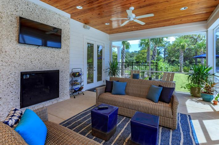 Clubhouse with screened porch and fireplace at The Townhomes at Beau Rivage in Wilmington, North Carolina.
