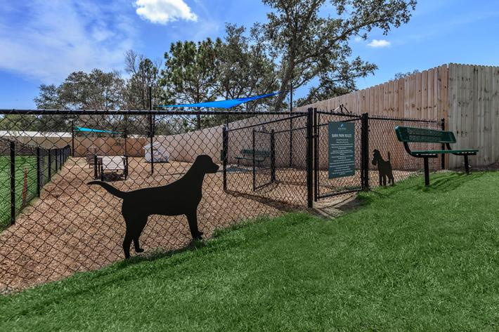 Dog park with agility equipment at The Townhomes at Beau Rivage in Wilmington, NC.