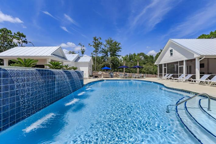 Enjoy the shimmering swimming pool at The Townhomes at Beau Rivage in Wilmington, North Carolina.