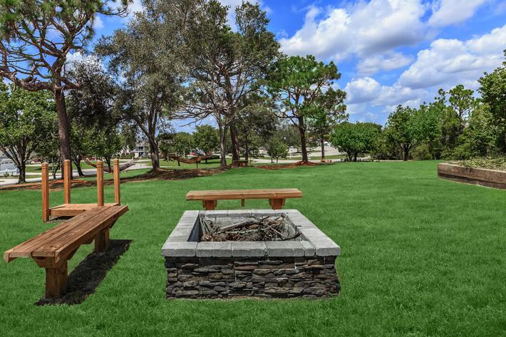 Fire pit and seating area at The Townhomes at Beau Rivage in Wilmington, NC.
