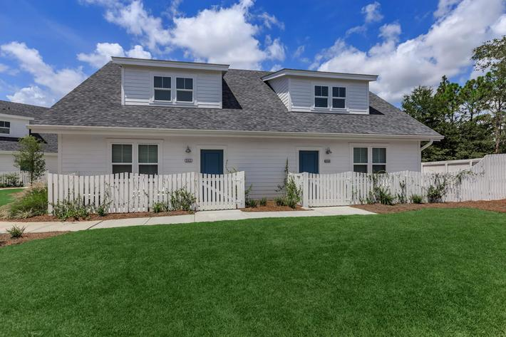 Private yards in select homes at The Townhomes at Beau Rivage in Wilmington, North Carolina.