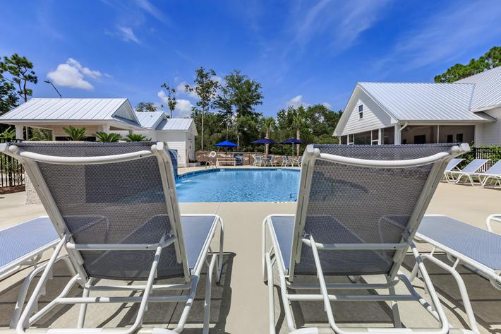 Relax by the pool at The Townhomes at Beau Rivage in Wilmington, NC.