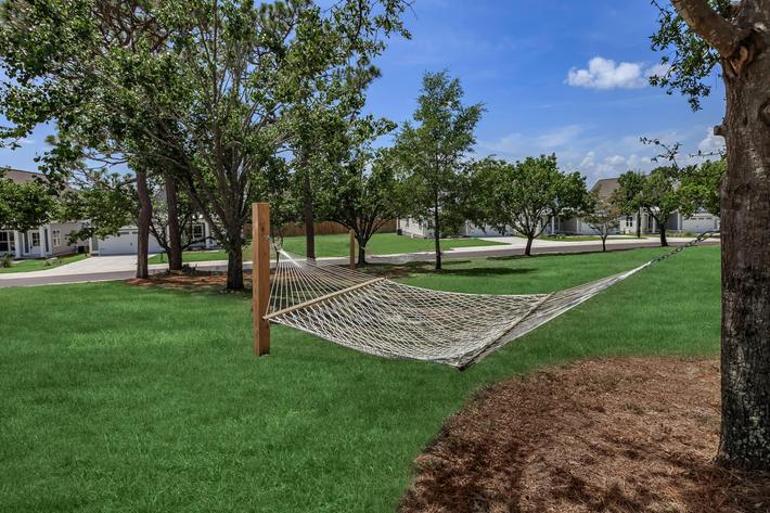 Relax outdoors at The Townhomes at Beau Rivage in Wilmington, North Carolina.