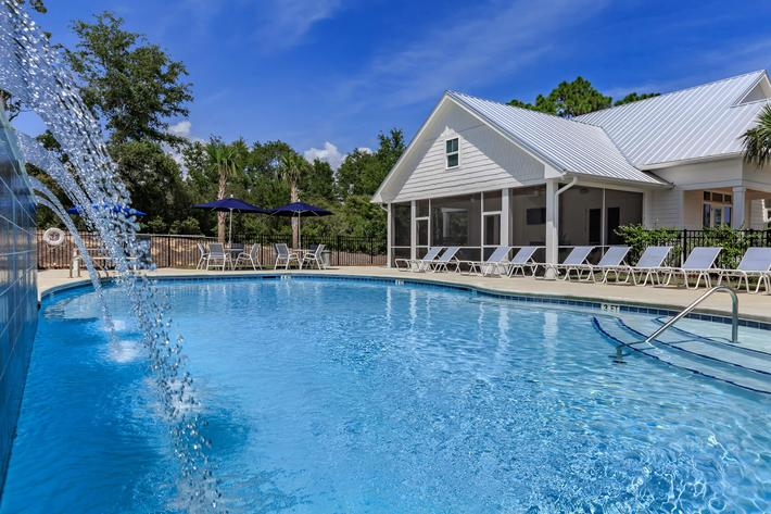 Saltwater swimming pool with waterfall at The Townhomes at Beau Rivage in Wilmington, NC.