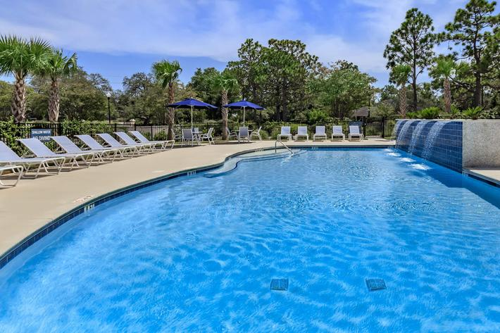 Shimmering swimming pool at The Townhomes at Beau Rivage in Wilmington, NC.
