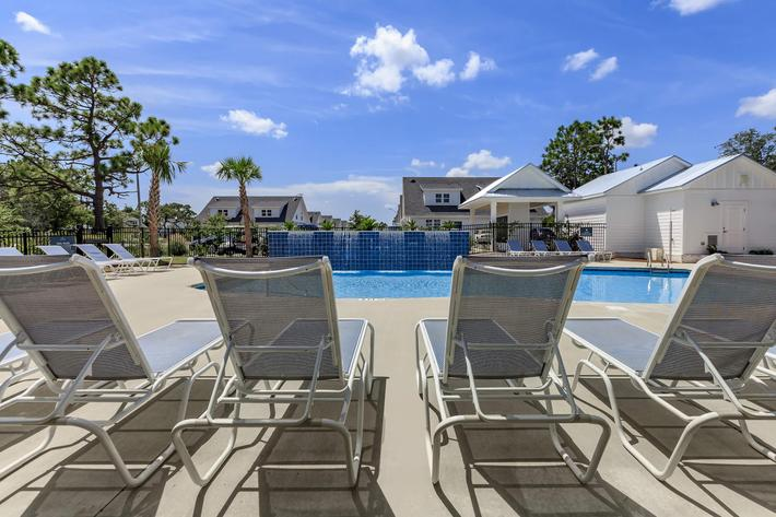 Soak up the sun by the swimming pool at The Townhomes at Beau Rivage in Wilmington, North Carolina.