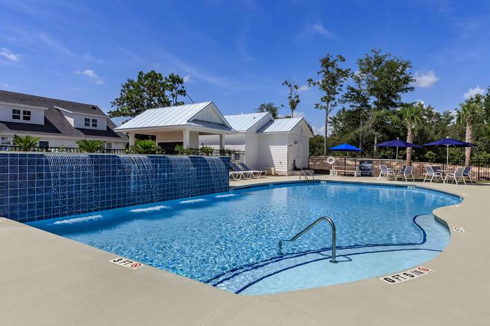 Splash around in the swimming pool at The Townhomes at Beau Rivage in Wilmington, NC.