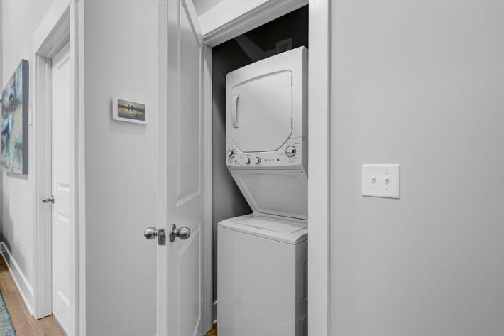 Washer and dryer units in home at The Townhomes at Beau Rivage in Wilmington, North Carolina.