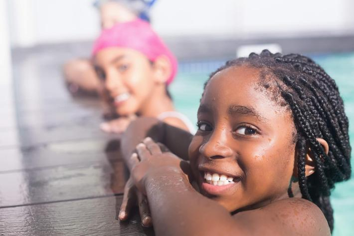 kids at pools edge - iStock-524428673_super.jpg