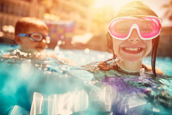 kids in pool, close up - iStock-685842534.jpg