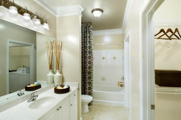 Bathroom with White Counter and Tub