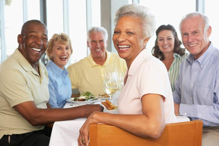Friends Having Lunch Together At A Restaurant iStock_19390084_LARGE.jpg