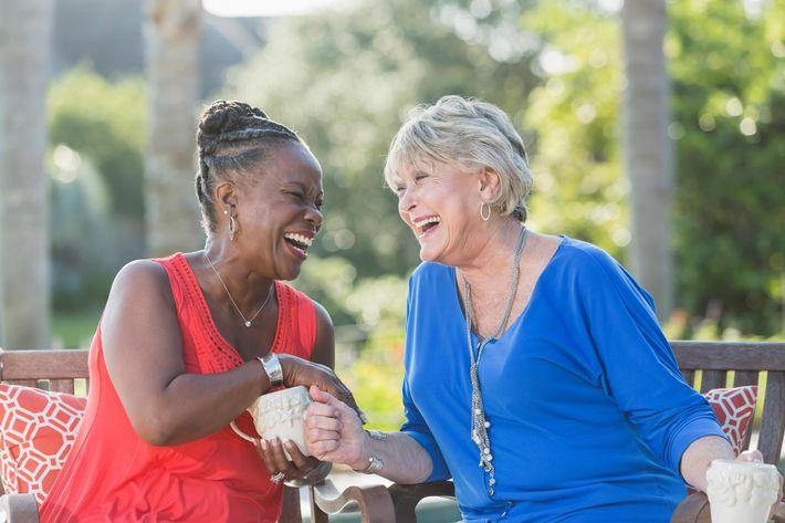 Senior women enjoying cup of coffee together, talking iStock_85670967_LARGE.jpg