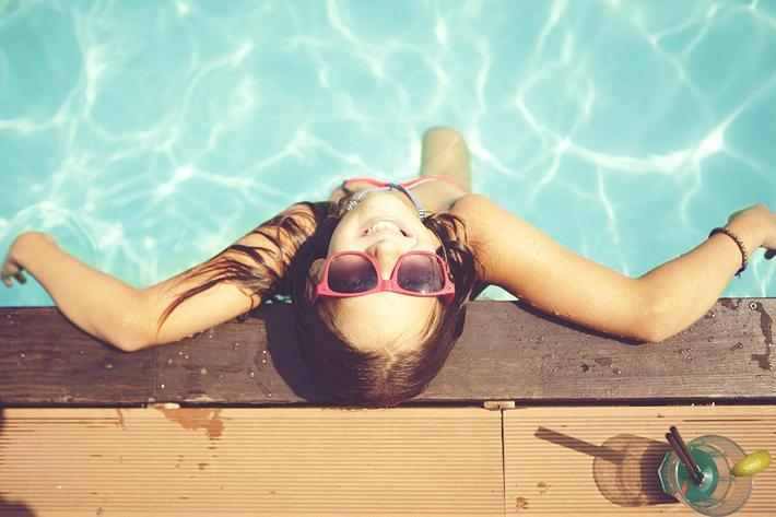 girl relaxing at pool.jpg