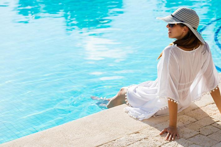 Lifestyle Photo of Woman with feet in the pool
