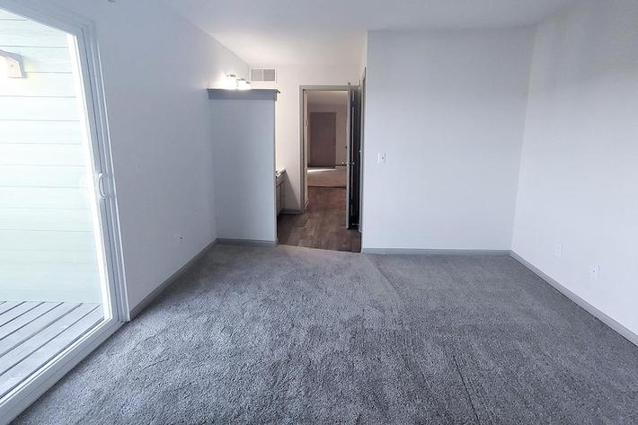 plush carpeting in the living room at Sunrise Apartments in Nashville, Tennessee