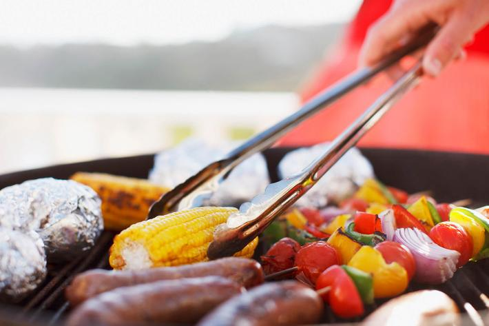 Close up of man grilling food on barbecue iStock-102283848.jpg