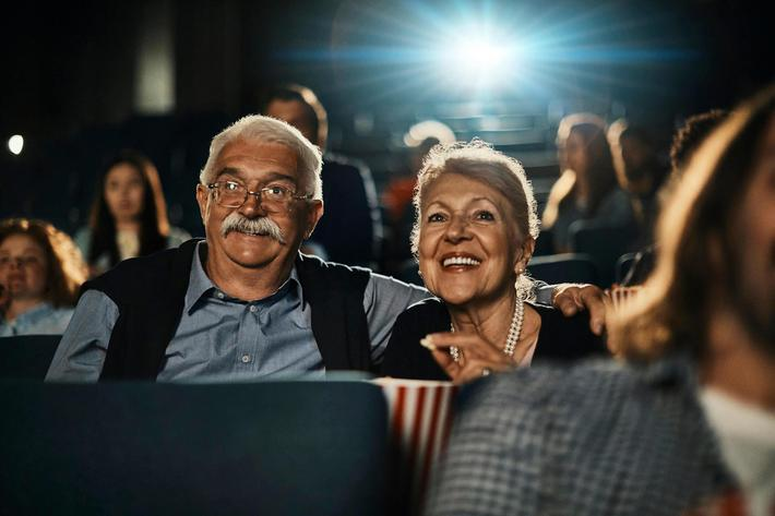 Movie-Theater-Caucasian-Senior-Couple-970593656.jpg
