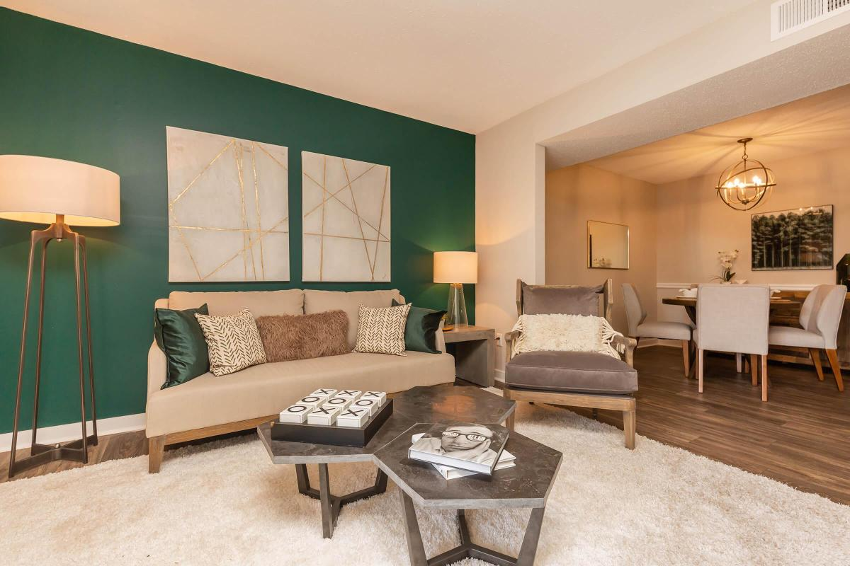 SPACIOUS LIVING ROOM AT MADISON LANDING AT RESEARCH PARK AND THE COTTAGES APARTMENTS