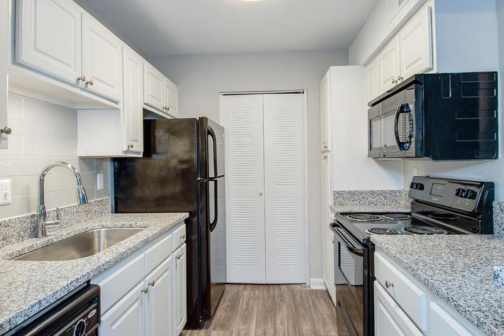 All-electric Kitchen in Ansley B at Madison Landing at Research Park Apartments in Madison, AL