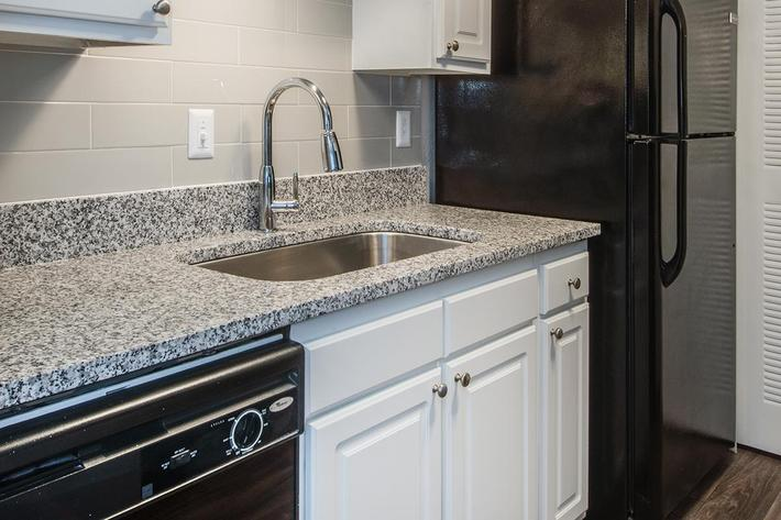 Granite Countertops at Madison Landing at Research Park Apartments in Madison, Alabama