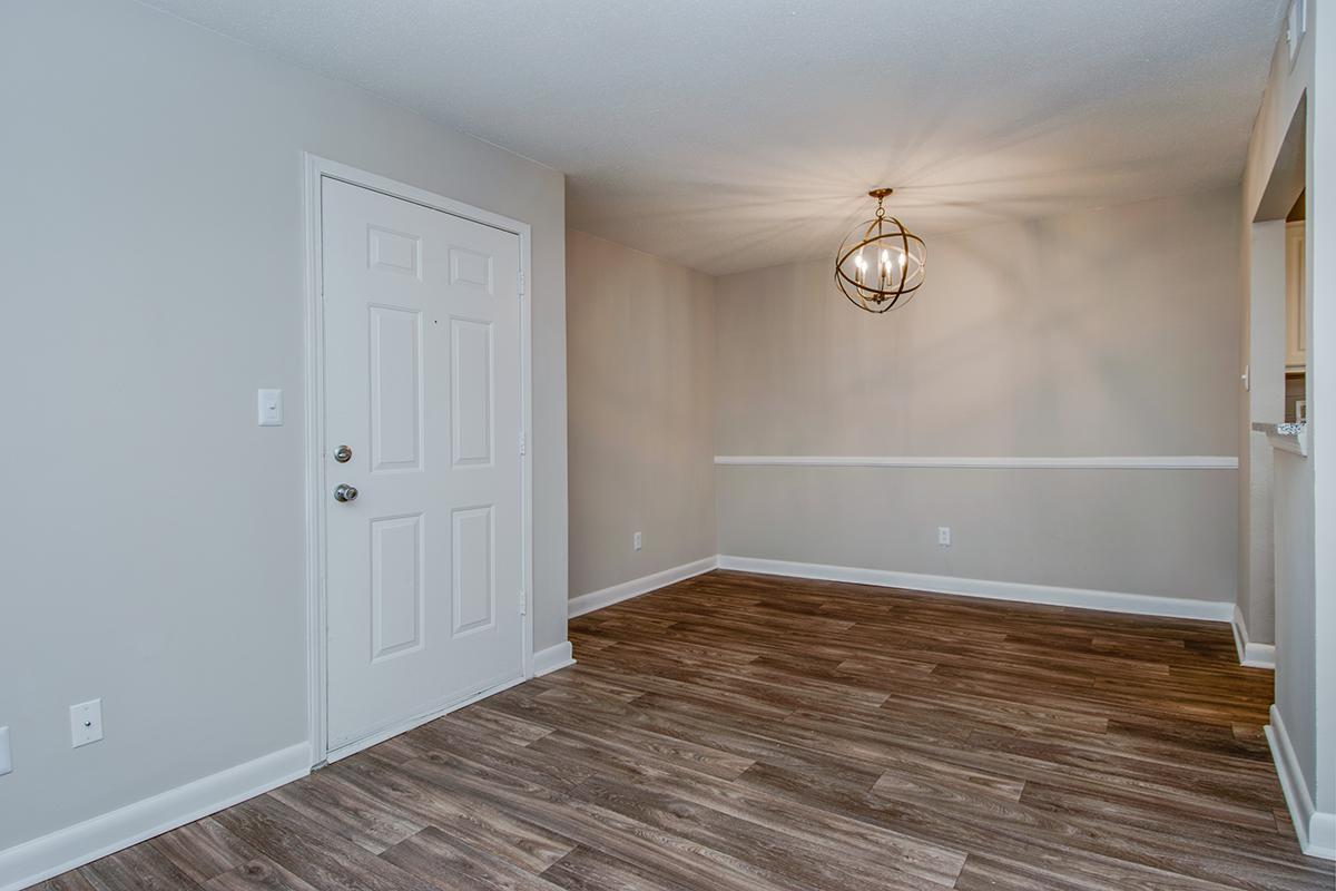 WOOD-STYLE FLOORING AT MADISON LANDING AT RESEARCH PARK AND THE COTTAGES APARTMENTS