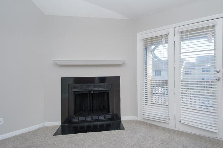Cozy Up to the Fireplace at Madison Landing at Research Park Apartments in Madison, AL