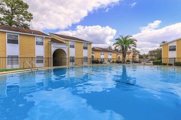 Swim some laps at Cross Creek Apartments in Jacksonville, Florida