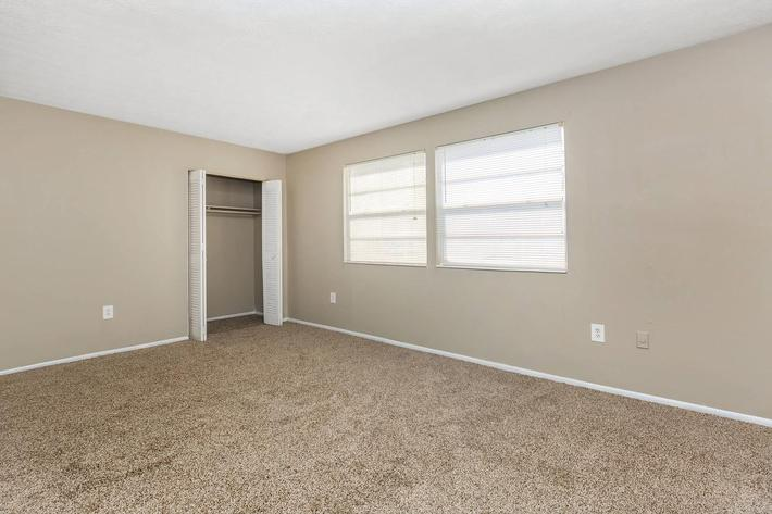 3 bed 3 bath carpeted bedroom at Cross Creek Apartments in Jacksonville, Florida