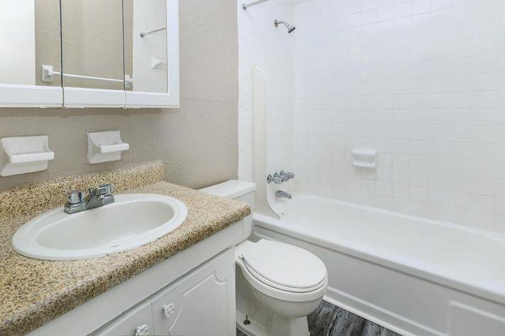 3 bed 3 bath modern bathroom here at Cross Creek Apartments in Jacksonville, Florida