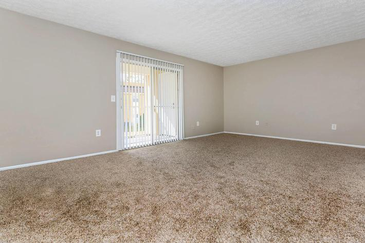 3 bed 3 bath living room here at Cross Creek Apartments in Jacksonville, Florida