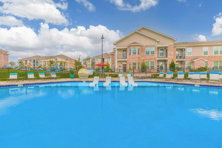 SPARKLING SWIMMING POOL AT APARTMENTS IN TALLAHASSEE, FL