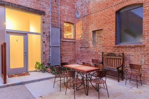 a chair sitting in front of a brick building