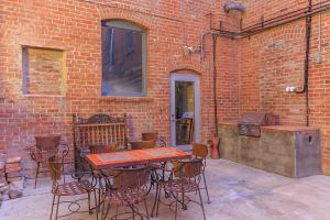 a fire place sitting in a chair in front of a brick building
