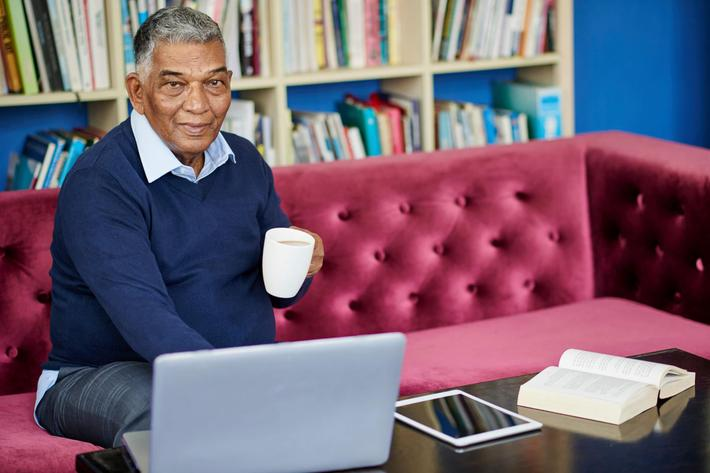 Senior man in library iStock_93976725_LARGE.jpg