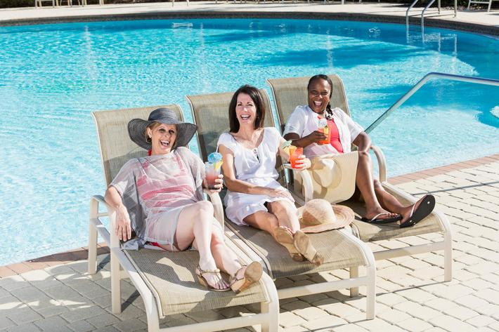 Women having drinks by swimming pooiStock-462869461.jpg