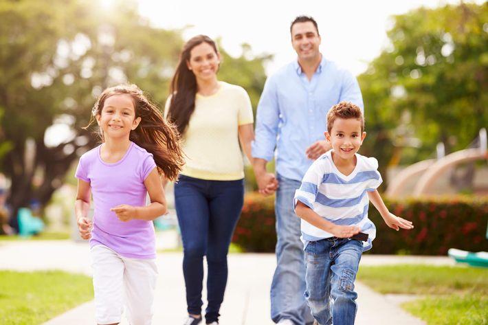 Hispanic Family Walking In Park Together iStock-514134693.jpg