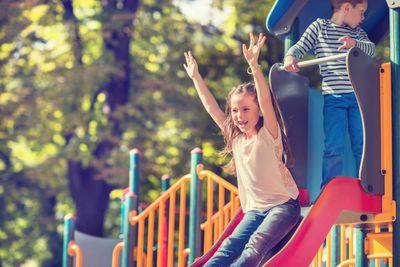 Little girl sliding outdoors iStock_000058410570_Large.jpg